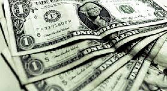 Dólar sobe à espera de decisões sobre juros nos EUA e Brasil
