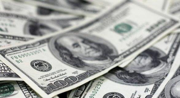 Taxas futuras de juros sobem com dólar forte em meio à cautela internacional